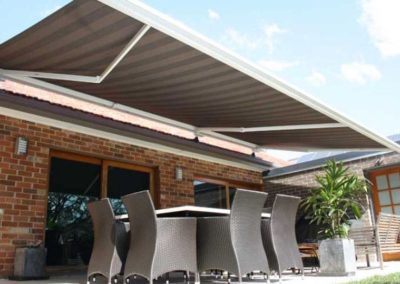 folding-arm-awnings-installed over outdoor dining area
