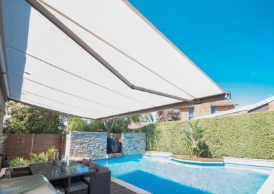 folding-arm-awnings-over pool and balcony area
