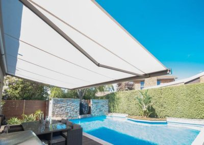folding-arm-awnings-over pool and balcony area_Shade Design